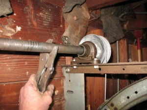 A vise grip placed on a shaft.