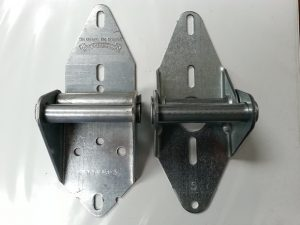 An image of an Overhead Door hing on the left side, next to an Arrow Tru-Line hinge on the right.