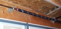 A view of a torsion spring with idler support brackets.