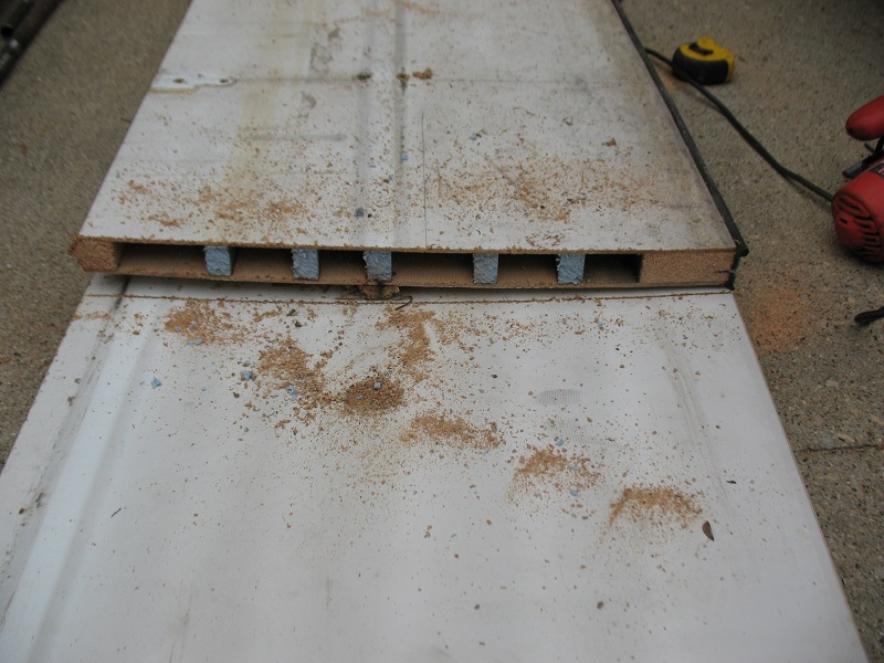These sections had exterior skins of hardboard or thin plywood that was glued to internal rails. The surface was kept uniformly flat with styrofoam strips. & Garage Door Sections - Danu0027s Garage Door Blog