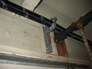 An angle iron supporting the spring anchor bracket.