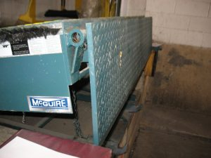 The side view of a Mcguire dock leveler.
