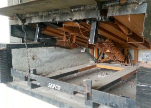 The front frame of a serco dock leveler that is lifted.