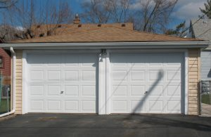 A picture of double white garage doors.