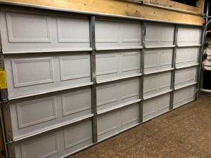 View of a white residential garage door.
