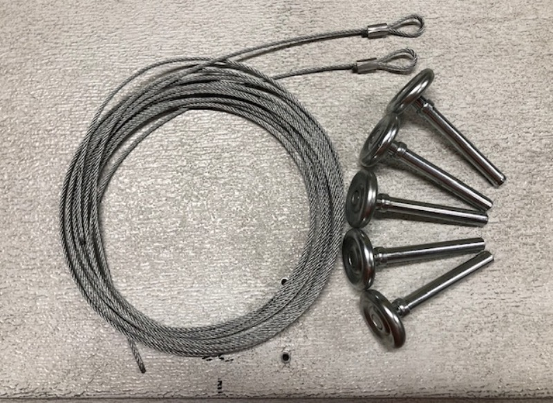Image of cable assembled with open loop and garage door rollers. This are garage door parts that are replaced with the use of tools for garage door repair.