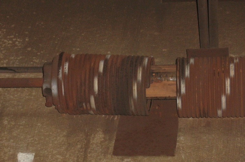 Image of a broken torsion spring on an overhead door.