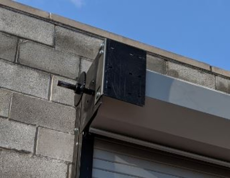 An installation showing a steel rolling door mounting bracket on the drive side of the door.