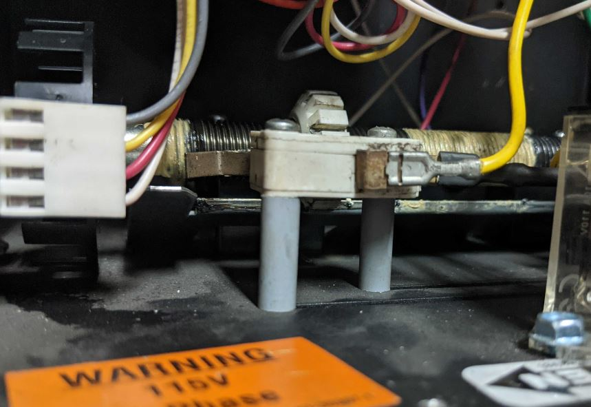 A side view of a limit switch installed through two small tubes.