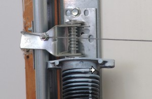 Position garage door torsion springs for proper installation.