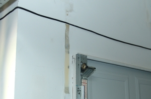 5.9 Remove The Flag Bracket From The Other Side Of The Garage Door.