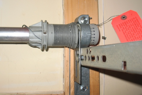 High lift garage door conversion for How to adjust garage door spring