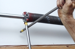 How to install a single torsion spring assembly bar against the top of the garage door insert a bar in the next hole and turn the plug up enough to allow you to push the marked bar back into place solutioingenieria Gallery