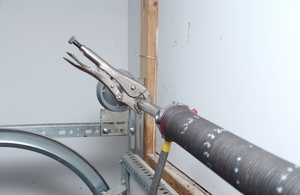 Single torsion spring replacement if the door comes up by itself when you hold the bar lightly the springs are either over wound or they are too strong you may need to remove 14 to 12 solutioingenieria Image collections