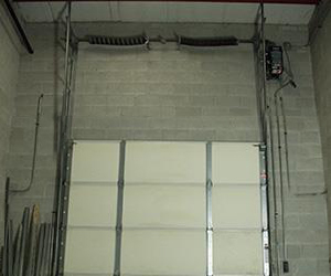 Garage door high lift conversion