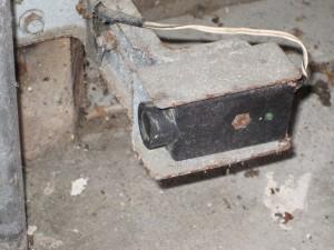 How to fix problems with garage door opener photo eyes a for Fix garage door sensor