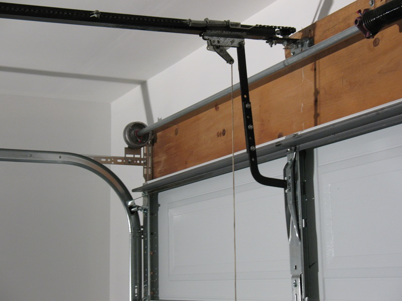 how to fix a garage door springHow Many Turns do You Wind a Torsion Spring  Dans Garage Door Blog
