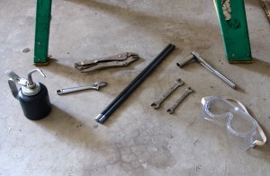 Gather the supplies and tools needed to replace garage door torsion springs.