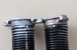 Repair workers take note: Double-check garage door torsion springs' winds to correctly replace springs.