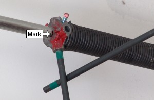 Stretch garage door torsion springs.