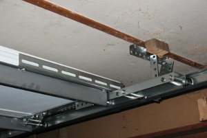 Low headroom modification for steel doors for Garage modification