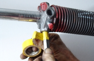 torsion spring winding bars. tape your winding bars, not only to assure that you are inserting the bars completely into cones as wind springs, but more importantly torsion spring d